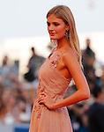 french model Constance Jablonski poses on the red carpet at the opening of the 71st Venice Film Festival in Venice, on August 27, 2014.