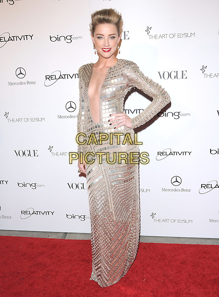 "AMBER HEARD .attends the Art of Elysium 4th Annual Charity Gala ""Heaven"" held at The Annenberg Building at The California Science Center in Los Angeles, California, USA, January 15th 2011..full length gold long sleeve maxi dress hand on hip low cut plunging neckline metallic studs studded beige                                                                              .CAP/RKE/DVS.©DVS/RockinExposures/Capital Pictures."
