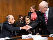 United States Senator Chuck Grassley (Republican of Iowa), left, shakes hands with US Senator Patrick Leahy (Democrat of Vermont), right, as US Senator Dianne Feinstein (Democrat of California), center, looks on prior to the US Senate Committee on the Judiciary holding a vote on the nomination of Judge Brett Kavanaugh to be Associate Justice of the US Supreme Court to replace the retiring Justice Anthony Kennedy on Capitol Hill in Washington, DC on Friday, September 28, 2018.  If the committee votes in favor of Judge Kavanaugh then it goes to the full US Senate for a final vote.<br /> Credit: Ron Sachs / CNP<br /> (RESTRICTION: NO New York or New Jersey Newspapers or newspapers within a 75 mile radius of New York City)