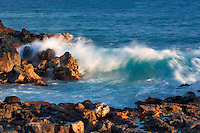 Waves off shoreline at Poipu. Kauai, Hawaii