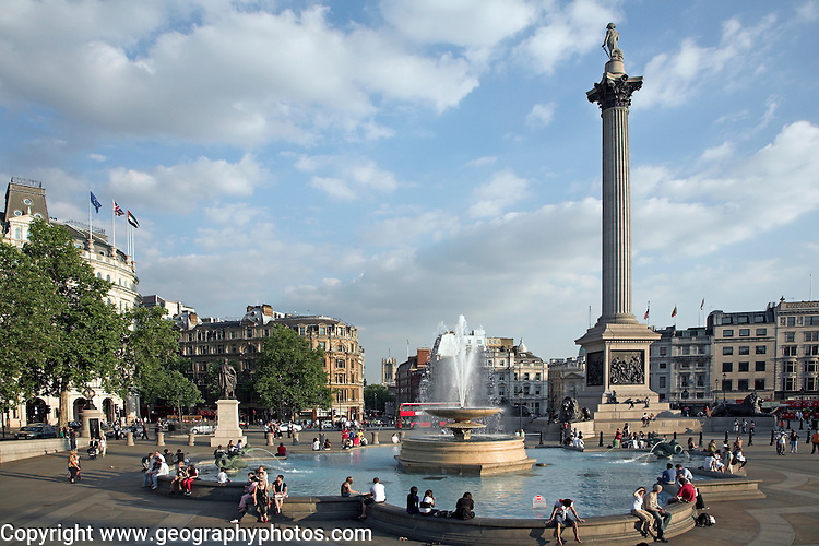 People, water fountain and Nelson´s column in Trafalgar Square, London, England