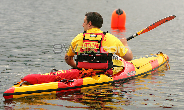 PICTURE BY VAUGHN RIDLEY/SWPIX.COM -  Swimming - Festival of Open Water Swimming - London Regatta Centre, Royal Albert Docks - London, England - 24-25/06/06...? Simon Wilkinson - 07811 267706...A Lifeguard prepares for the start of the LEN Open Water Cup/British Open Water Championship Race.