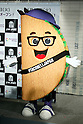 The Taco Bell mascot character poses for the cameras during the pre-opening event for their first Japanese store located in Tokyo's Shibuya district, on April 20, 2015, Japan. The store includes Japan specific dishes like shrimp and avocado burrito and taco rice on its menu. It will open to the public on April 21st. The American Tex-Mex fast food restaurant has signed a franchise agreement with Asrapport Dining Co., Ltd. to operate Taco Bell branches in Japan. (Photo by Rodrigo Reyes Marin/AFLO)