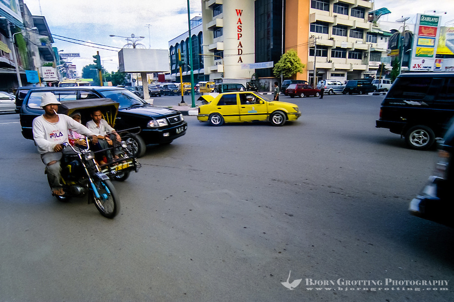 Indonesia, Sumatra. Medan. Keep your walks in Medan as short as possible. The sidewalks are in bad shape, the traffic dense and noisy and the air thick.