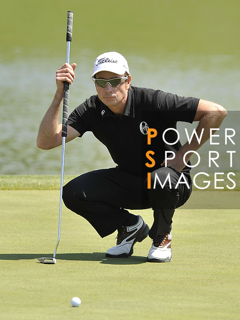 JEJU, SOUTH KOREA - APRIL 25:  Brett Rumford of Australia lines up a putt on the 2nd green during the Round Three of the Ballantine's Championship at Pinx Golf Club on April 25, 2010 in Jeju, South Korea. Photo by Victor Fraile / The Power of Sport Images