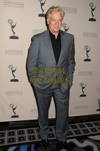 Christopher McDonald.Academy of Television Arts & Sciences' Performers Peer Group Celebrates the 63rd Primetime Emmy Awards held at the Sheraton Universal Hotel, Universal City, California, USA..August 22nd, 2011.full length suit top hands in pockets black grey gray.CAP/ADM/BP.©Byron Purvis/AdMedia/Capital Pictures.