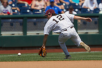 Mississippi State shortstop Adam Fraizer (12) fields a ground ball during Game 11 of the 2013 Men's College World Series against the Oregon State Beavers on June 21, 2013 at TD Ameritrade Park in Omaha, Nebraska. The Bulldogs defeated the Beavers 4-1, to reach the CWS Final and eliminating Oregon State from the tournament. (Andrew Woolley/Four Seam Images)