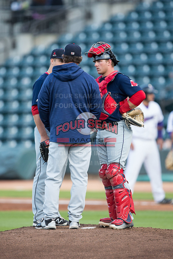 Salem Red Sox catcher Ben Moore (29) listens to pitching coach Paul Abbott as he talks to starting pitcher Jalen Beeks (31) during the game against the Winston-Salem Dash at BB&T Ballpark on April 15, 2016 in Winston-Salem, North Carolina.  The Red Sox defeated the Dash 3-2.  (Brian Westerholt/Four Seam Images)