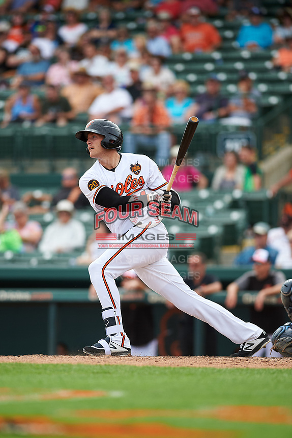 Baltimore Orioles left fielder Zach Jarrett (94) follows through on a swing during a Grapefruit League Spring Training game against the Tampa Bay Rays on March 1, 2019 at Ed Smith Stadium in Sarasota, Florida.  Rays defeated the Orioles 10-5.  (Mike Janes/Four Seam Images)