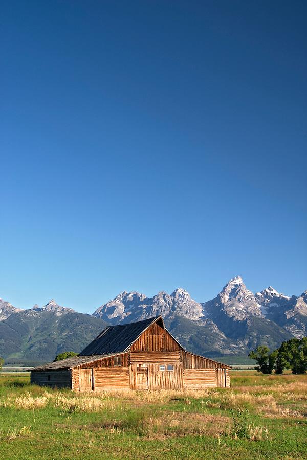 Old barn below the Teton Mountains, Grand Teton National Park, Teton County, Wyoming, USA