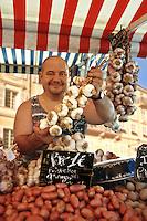 Garlic seller at market stall, Cours Saleya, Nice, France