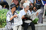 SEPTEMBER 8, 2013 : Pedestrian read an extra edition reporting Tokyo won the bid to host the 2020 Summer Olympic Games in Tokyo Japan on Sunday September 8, 2013. (Photo by AFLO SPORT) [1156]