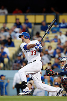 Scott Van Slyke #33 of the Los Angeles Dodgers bats against the Atlanta Braves at Dodger Stadium on June 6, 2013 in Los Angeles, California. (Larry Goren/Four Seam Images)