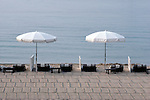 Sifted sand creates interesting patterns as the umbrellas & chaise loungers await the crowds.