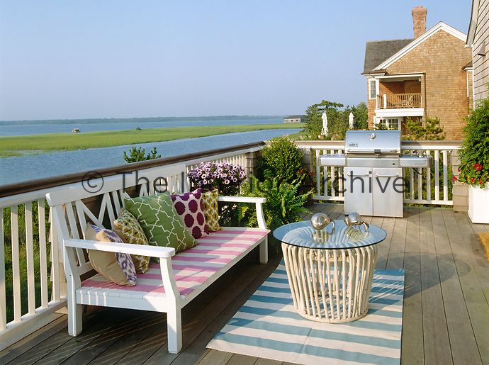 The deck offers stunning views over the marshland and is equipped with a state of the art barbeque