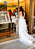Bride at an American Express office in Venice, Italy, October 28, 2013.<br /> Credit: Ron Sachs / CNP