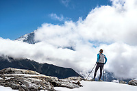 A trail runner looking tired while on Renjo La Pass, the last pass, while doing the whole 3 Passes Tour, Khumbu Valley, Nepal.