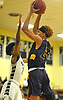 Darryan Fuentes #24 of Central Islip, right, drives to the net during a non-league varsity boys basketball game against Elmont in the Richard Brown Nassau-Suffolk Challenge at Uniondale High School on Saturday, Jan. 13, 2018. Central Islip won by a score of 63-56.