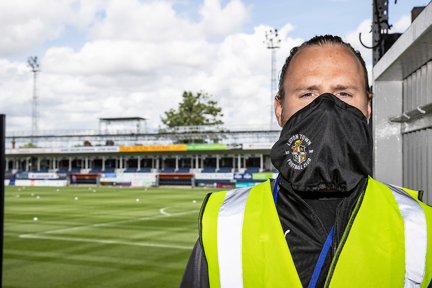 A steward wearing a Luton Town face mask at the Kenilworth Road stadium<br /> <br /> Photographer Andrew Kearns/CameraSport<br /> <br /> The EFL Sky Bet Championship - Luton Town v Preston North End - Saturday 20th June 2020 - Kenilworth Road - Luton<br /> <br /> World Copyright © 2020 CameraSport. All rights reserved. 43 Linden Ave. Countesthorpe. Leicester. England. LE8 5PG - Tel: +44 (0) 116 277 4147 - admin@camerasport.com - www.camerasport.com