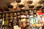Display of naval caps and hats in pub, Gibraltar, British terroritory in southern Spain