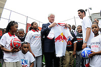 Juan Pablo Angel of the New York Red Bulls presents former President Bill Clinton with a New York Red Bulls jersey prior to a press conference announcing former President Bill Clinton as the honorary chairman of the USA Bid Committee to host the FIFIA World Cup in 2018 or 2022 at the FC Harlem Field in Harlem, NY, on May 17, 2010.