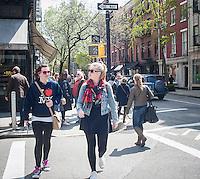 Shopping on trendy Bleecker Street in New York on Saturday, April 20, 2013, 2013. (© Richard B. Levine)