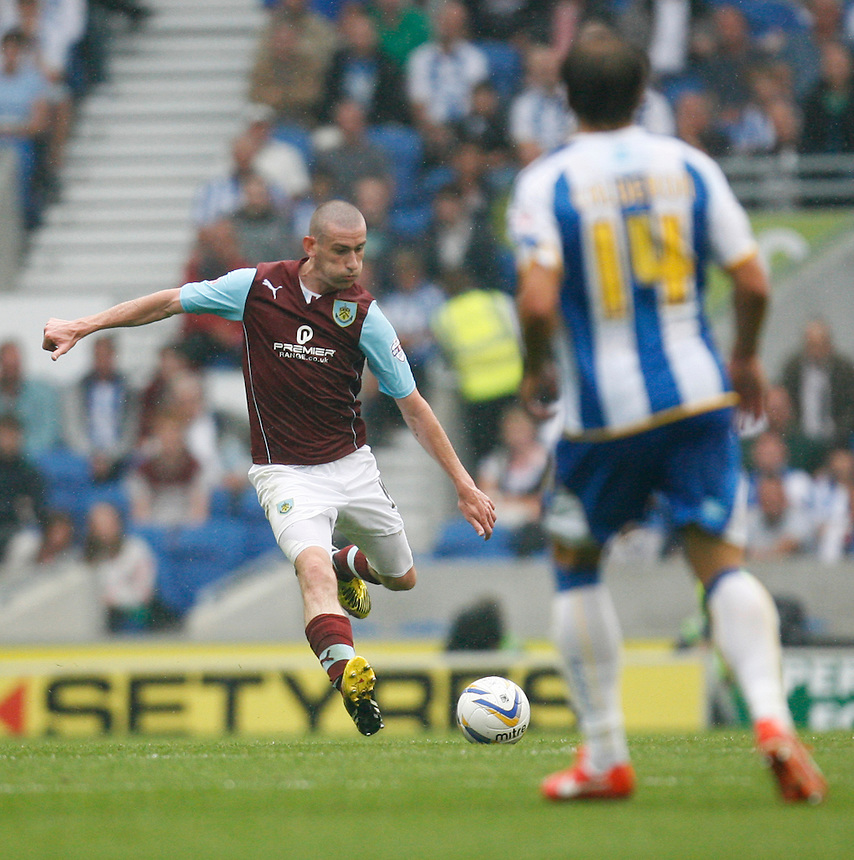 Burnley's David Jones (L) in action during todays match  <br /> <br /> (Photo by Jack Phillips/CameraSport)<br /> <br /> Football - The Football League Sky Bet Championship - Brighton and Hove Albion v Burnley - Saturday 24th August 2013 - American Express Community Stadium - Brighton<br /> <br /> &copy; CameraSport - 43 Linden Ave. Countesthorpe. Leicester. England. LE8 5PG - Tel: +44 (0) 116 277 4147 - admin@camerasport.com - www.camerasport.com