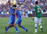 BOGOTA -COLOMBIA. 05-04-2014. Fabian Vargas (De)de Millonarios   celebra su gol con Andres Cadavid (Izq) contra el Deportivo Cali  por la quinceava  fecha de La liga Postobon 1 disputado en el estadio Nemesio Camacho El Campin. /   Fabian Vargas (R)  and Andres Cadavid of Millonarios  celebrates his goal  against Deportivo Cali  during the match for the fifteenth  round of The Postobon one league match at Nemesio Camacho El Campin  Stadium . Photo: VizzorImage/ Felipe Caicedo / Staff