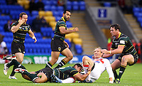 PICTURE BY ALEX WHITEHEAD/SWPIX.COM - Rugby League - International Origin Match - England vs Exiles - The Halliwell Jones Stadium, Warrington, England - 14/06/13 - England's Eorl Crabtree is tackled by Exiles' Mickey Paea.