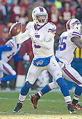 Buffalo Bills quarterback Tyrod Taylor (5) looks for a receiver in first quarter action against the Washington Redskins at FedEx Field in Landover, Maryland on Sunday, December 20, 2015.  The Redskins won the game 35-25.<br /> Credit: Ron Sachs / CNP