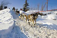 Louis Nelsons team mushes out of McGrath Chkpt onto Kuskokwim River 2006 Iditarod Interior AK Winter