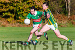 Daniel O'Shea Tousist is tackled by Tom Kavanagh in the Novice Championship final in Listry on Sunday
