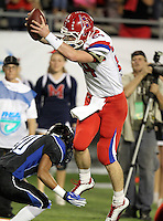 Manatee Hurricanes quarterback Cord Sandberg #24 jumps over a defender into the end zone on a 12 yard TD run in the first quarter of the Florida High School Athletic Association 7A Championship Game at Florida's Citrus Bowl on December 16, 2011 in Orlando, Florida.  The score at halftime is Manatee 17 - First Coast 0.  (Mike Janes/Four Seam Images)