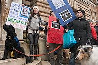 "New York, NY -  11 February 2012 Dogs dressed in Under Dog costumes and accompanied by their guardians march from the Mercer Houston Dog Run to Judson Memorial Church, calling for ""Paws Off"" in support of a rally to stop NYU's 2031 plan expansion...Under New York University's 2031 plan the Mercer Houston Dog Run and NYU Cole Sports Center would be demolished to build a ""Zipper Building"" on the Superblock."