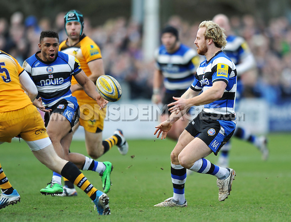 Nick Abendanon passes the ball to Kyle Eastmond. Aviva Premiership match, between Bath Rugby and London Wasps on February 22, 2014 at the Recreation Ground in Bath, England. Photo by: Patrick Khachfe / Onside Images