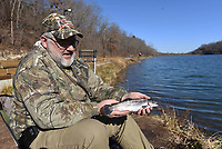 NWA Democrat-Gazette/FLIP PUTTHOFF <br /> Bill Caplinger of Sulphur Springs shows one of the rainbow trout he caught Saturday Dec. 22 2018 at Lake Atalanta near downtown Rogers. Anglers report good fishing at all the region's small lakes where trout are stocked during winter.