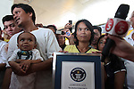 Reynaldo and Concepcîon Balawing speak to reporters in the town of Sindangan, Mindanao island, Philippines, after Guiness World Records named their son Junrey, 18, (shown here held by his father) as the world's shortest living man. He stands only 23.5 inches tall.  June 12, 2011. DREW BROWN/MCT