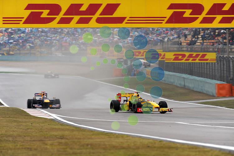 F1 GP of China, Shanghai 16.- 18. April 2010.Robert Kubica (POL), Renault F1 Team - Sebastian Vettel (GER), Red Bull Racing ..Hasan Bratic;Koblenzerstr.3;56412 Nentershausen;Tel.:0172-2733357;.hb-press-agency@t-online.de;http://www.uptodate-bildagentur.de;.Veroeffentlichung gem. AGB - Stand 09.2006; Foto ist Honorarpflichtig zzgl. 7% Ust.;Hasan Bratic,Koblenzerstr.3,Postfach 1117,56412 Nentershausen; Steuer-Nr.: 30 807 6032 6;Finanzamt Montabaur;  Nassauische Sparkasse Nentershausen; Konto 828017896, BLZ 510 500 15;SWIFT-BIC: NASS DE 55;IBAN: DE69 5105 0015 0828 0178 96; Belegexemplar erforderlich!..