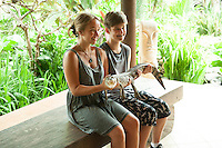 The girls with a baby salt-water crocodile.<br />