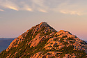 The summit cone of Mount Chocorua is bathed in dawns first light at the start of another beautiful day in New Hampshires White Mountains.
