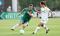 Melissa Tancredi (green) takes on Stephanie Cox...Saint Louis Athletica and LA Sol played to a 0-0 tie at Robert Herman Stadium, St Louis, MO.