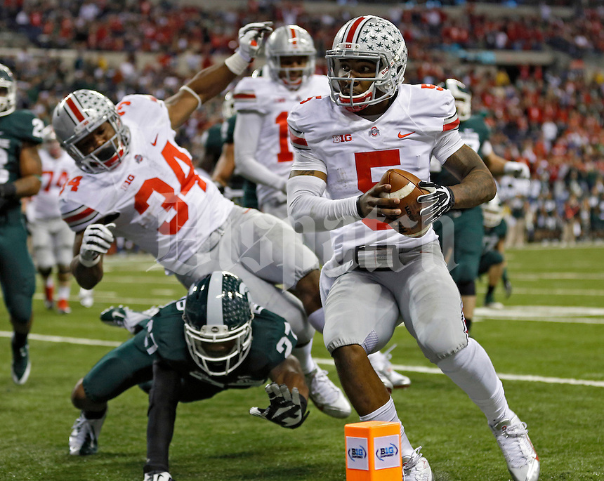 Ohio State Buckeyes quarterback Braxton Miller (5) scores on a touchdown run against Michigan State Spartans in the 3rd quarter during the Big 10 Championship game at Lucas Oil Stadium in Indianapolis, Ind on December 7, 2013.  (Dispatch photo by Kyle Robertson)
