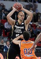 Valencia Basket Club's Rodrigo San Miguel (r) and Herbalife Gran Canaria's Xavi Rey during Spanish Basketball King's Cup semifinal match.February 07,2013. (ALTERPHOTOS/Acero) /NortePhoto