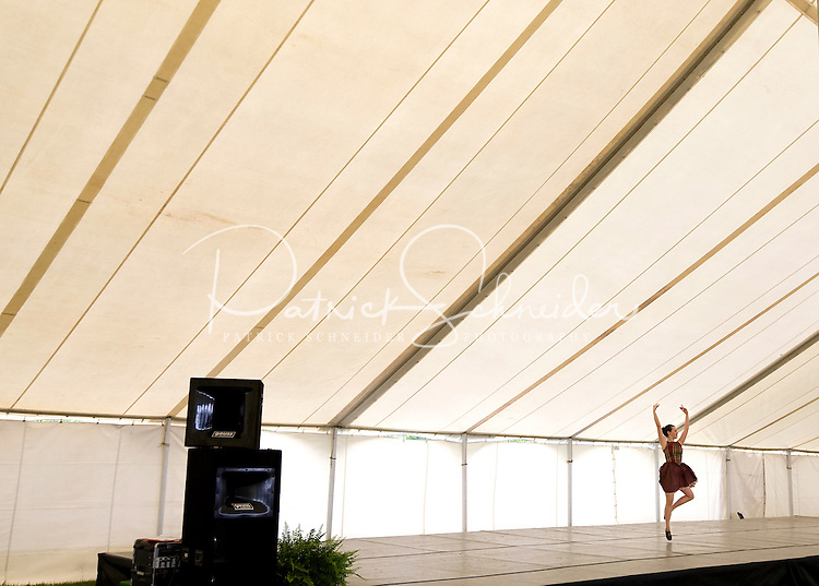A young woman practices her dance performance at the Loch Norman games in Huntersville, NC.