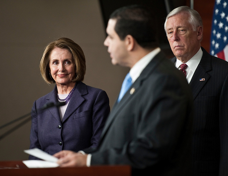 WASHINGTON, DC- Jan. 04: House Minority Leader Nancy Pelosi, D-Calif., Rep. Henry Cuellar, D-Texas, and House Minority Whip Steny Hoyer, D-Md., during a news conference on their agenda for the first session of the 112th Congress, which begins Wednesday. Cuellar is a vice chair of the House Democratic Steering and Policy Committee. (Photo by Scott J. Ferrell/Congressional Quarterly)