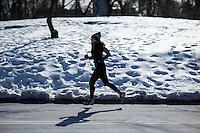A woman jokes inside central park during low temperatures in New York. 16.02.2015. Eduardo Munoz Alvarez/VIEWpress.