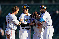 Mesa Solar Sox Yu-Cheng Chang (13), of the Cleveland Indians organization, is congratulated by teammates Austin Nola (8), Brian Anderson (14) and Anthony Alford (22) after a walk off hit during a game against the Scottsdale Scorpions on October 21, 2016 at Sloan Park in Mesa, Arizona.  Mesa defeated Scottsdale 4-3.  (Mike Janes/Four Seam Images)
