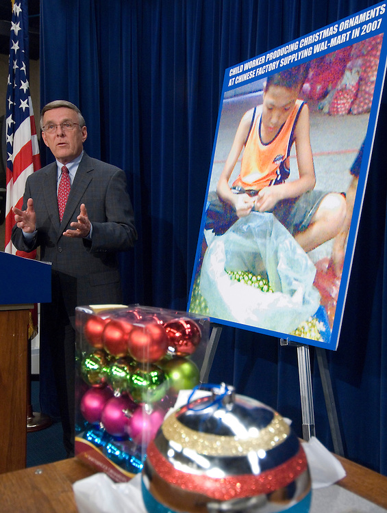 Sen. Byron Dorgan, D-N.D. holds a news conference on Wednesday, Dec. 12, 2007, to release the results of a study that found Christmas tree ornaments sold across the country were produced in illegal sweatshop conditions in China.