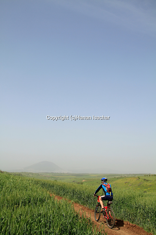 Israel, cycling in the Lower Galilee, Mount Tabor is in the background
