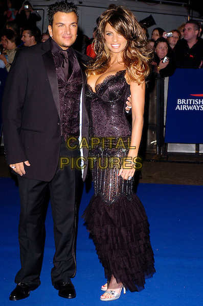 JORDAN & PETER ANDRE.National Television Awards 2005 at the Royal Albert Hall. London, UK.October 25th 2005.Ref: CAP/JH.full length Katie Price with together celebrity couple married wife husband matching outfit outfits black corset lace ruffle ruffles flamenco style .www.capitalpictures.com.sales@capitalpictures.com.© Copyright 2005 Adrian Seal, Photoscene.biz Midtownstudios 50 Acton Mews,London E84EA Tel:07973673832.
